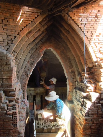 Ladies stacking the furnace with clay bricks...