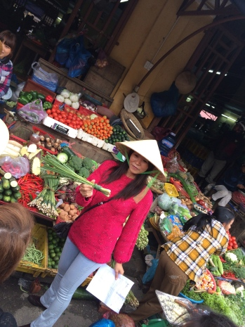 Our gracious host, Van, picking out the necessary ingredients from Hoi An's central market.